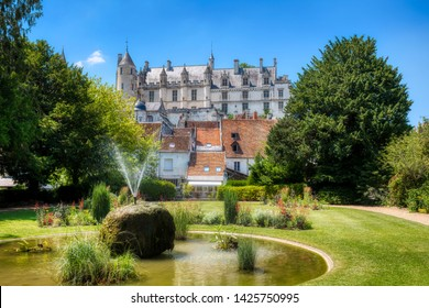 Fountain in the Public Garden in Loches, Loire Valley, France, with the Royal Lodge of the Castle of Loches