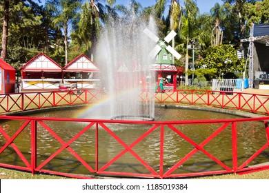 Fountain with rainbow in public park