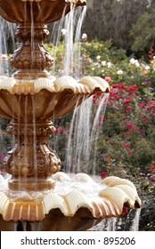 A fountain in a rose garden