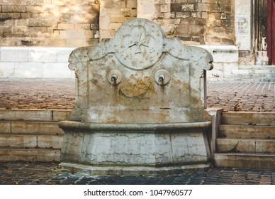 Fountain Saint Jean de Malte decorated with cross, symbol of Maltese Order in Aix-en-Provence, France