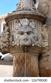 Fountain of serious lion in old town of Dubrovnik, Croatia