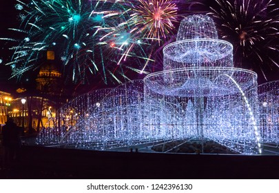 fountain from the shining fires on the square in front of St. Isaac Cathedral on New Year's Eve. St. Petersburg. Russia and Christmas fireworks