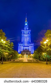 a fountain situated in front of the Palace of culture and science during night in Warsaw, poland.