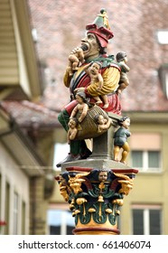 A fountain topped by a sculpture of an ogre eating children in Bern, Switzerland