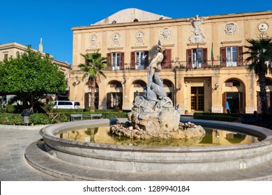 Fountain and Town Hall on a square near Cathedral. Monreale, Sicily, Italy