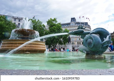 Fountain at the Trafalgar Square, Westminster, London, England. Photo was taken on 15/06/2019. Statue featuring mermen/mermaid, water creatures and dolphins.