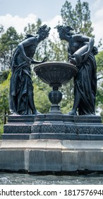 Fountain of Two Women Pouring Down Water Into a Bird Waterer