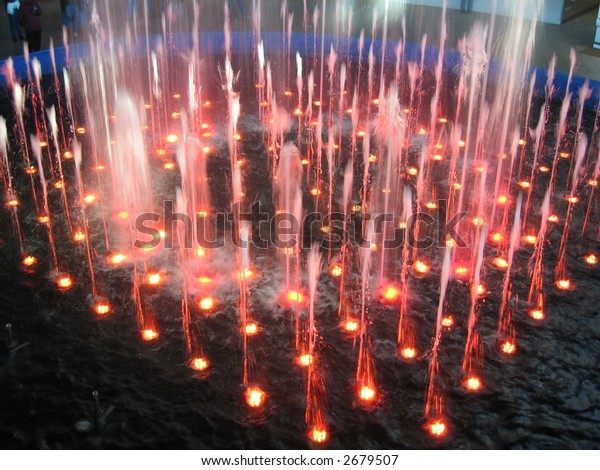 fountain of water with colorful lights