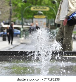 fountain of water splashing near  a subway station in Montreal