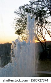 Fountain with water at sunset