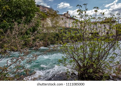 Fountain-of-Vaucluse, FRANCE - April 18th, 2018. Located in the department of Vaucluse. Sorgue runs like a torrent through the trees and vegetation.
