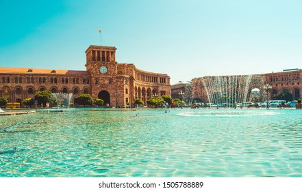 Fountains and beautiful architectural complex on Republic Square. Touristic landmark. Sightseeing Yerevan. City tour. Government House. Travel, tourism concept. Sunny autumn day. Armenian architecture