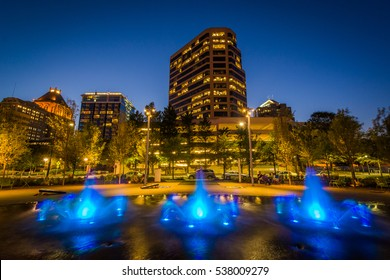 Fountains and buildings at Lebauer Park at night, in downtown Greensboro, North Carolina.