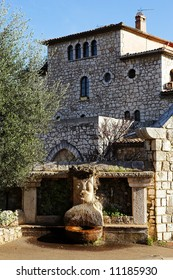 Fountains and buildings with windows and doors in the quaint little French hilltop village of Saint-Paul de Vence, Southern France,  Alpes Maritimes, next to the Mediterranean sea - A Heritage Site