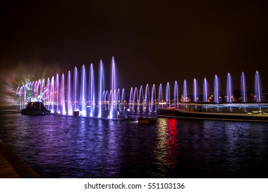 Fountains light art at night during the Amsterdam Light Festival.