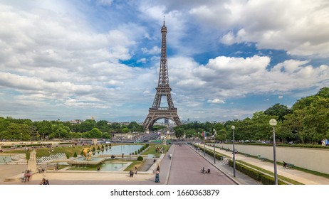 Fountains on famous square Trocadero with Eiffel tower in the background timelapse . Trocadero and Eiffel tower are the most visited attractions of Paris. Blue cloudy sky at summer day