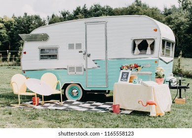 Fountaintown, IN / USA - 08 18 2018: Wedding details on table, Vintage Camper, photography prop set up.