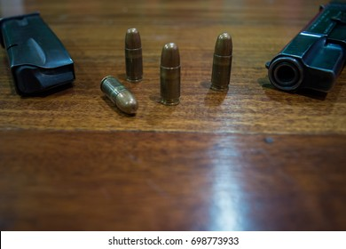 Four 9mm bullets and a gun