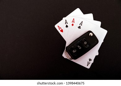 Four Aces With Car Key. Aces high on black background with copy space for text.