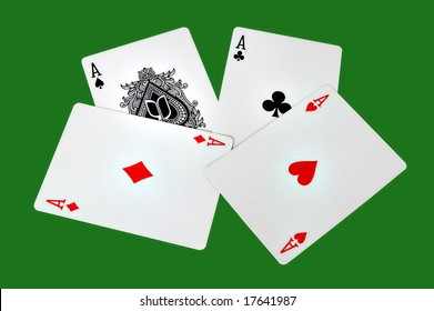 Four aces isolated in a green background with clipping path