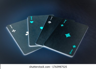 Four aces on a black table. Inversion