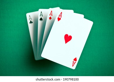 the four aces on green casino table