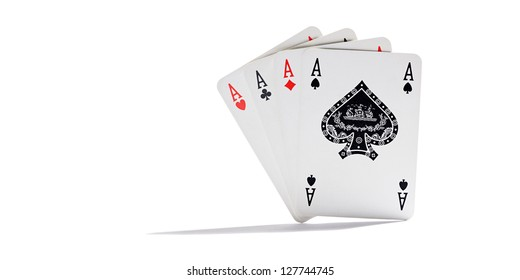 Four aces representing the four suits in playing cards standing upright and fanned on a white background with copy space conceptual of gambling and casinos