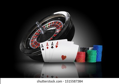 Four aces standing on a mirror surface with backlight, ahead of dark roulette and chips in piles. Black background. Gambling entertainment. Close-up.