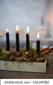 Four advent candles burning