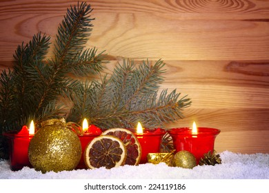 Four Advent Candles and christmas ball.