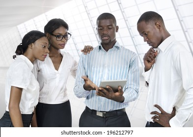 Four african business people with tablet PC, Studio Shot