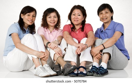 Four Asian women sitting together