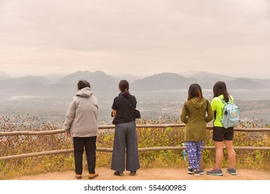 four asian women at view point to look mountain landscape,travel concept.