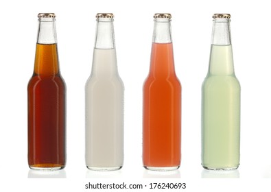 Four assorted soda bottles, non-alcoholic drinks with water drops