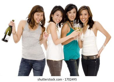 Four attractive girls enjoying a bottle of champagne