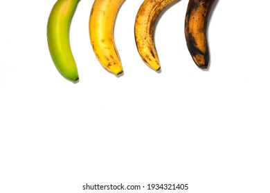 Four bananas - green underripe, ripe, very ripe and over ripe - in line. Banana ripeness. Concept of life cycle, ranging from young to old. White background, isolated. - Shutterstock ID 1934321405