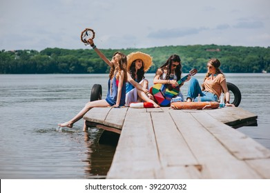 four beautiful girl friends on the dock