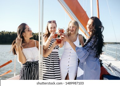 Four beautiful women friends resting on the yacht in the sea.  Lifestyle and relax concept. Hen-party