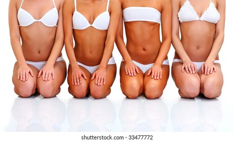 Four beautiful young women in white underwear sit in a lap blindly, isolated on a white background, please see some of my other parts of a body images