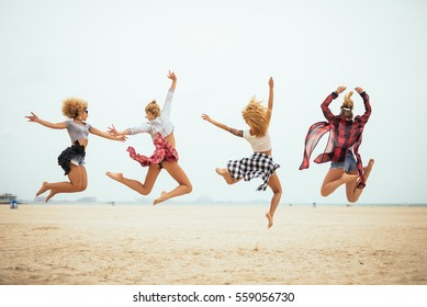 Four best friends having fun on a sunny day on the beach.