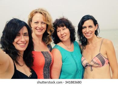 four best girlfriends making selfie-photo at seaside