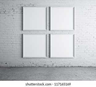 four blank frame on a concrete wall