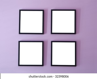 Four blank picture/photo frames on wall