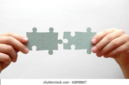four blank puzzle pieces