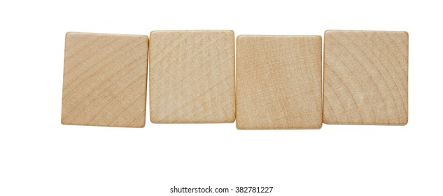 Four blank wooden tile pieces in a row isolated on a white background