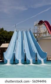 Four blue water toboggans