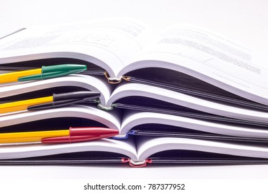 Four books with multi-colored handles