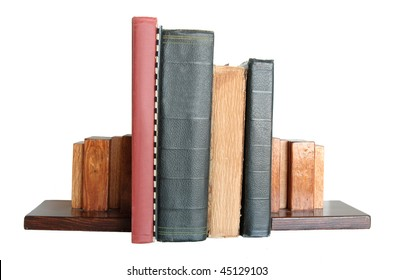 Four books standing up with book ends isolated on white background.