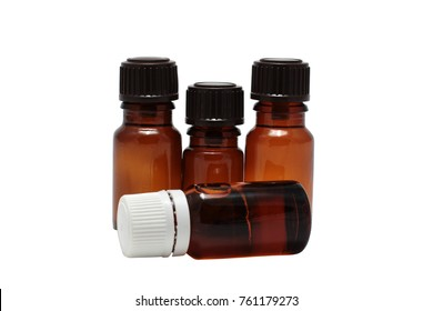four bottles of aromatherapy oils isolated