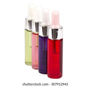 Four bottles of cosmetics isolated on white background